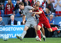 HOOVER, AL - DECEMBER 09, 2012: Kyle Sparks (21) of Indiana University moves in on Jimmy Nealis (16) of Georgetown University during the NCAA 2012 Men's College Cup championship, at Regions Park, in Hoover , AL, on Sunday, December 09, 2012.