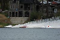 "J. Michael Kelly, E-42 , Jim Mauldin, E-31 and Kip Brown, E-1 ""MY-Way"" race into the first turn. (5 Litre class hydroplane(s)"