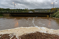 Pictured: The lever of river Neath has risen to almost the same as the A465 dual carriageway by Aberdulais Falls in south Wales, UK. Saturday 13 October 2018<br /> Re: Flooding caused by Storm Callum in Aberdulais near Neath, south Wales, UK.