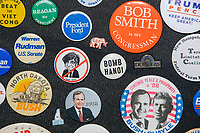 """Vintage Republican campaign pins and buttons, including one against Dukakis, an elephant labeled GOP, Bush/Quayle, and """"Bomb Hanoi"""" are seen in a wall display in the office of the New Hampshire Republican State Committee in Concord, New Hampshire, on Wed., Sept. 16, 2020."""