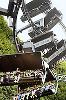 China. Shanghai. World Expo. Expo 2010 Shanghai China. Switzerland Pavilion. The most distinguished feature of the Switzerland Pavilion is the chair lift ride. The jouney takes about 10 minutes. The chair lift takes people up and out to the roof garden from the inside pavilion.The chairs are sheltered to ensure operation under the raining weather.  27.06.10 © 2010 Didier Ruef