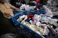 "Pracowniczki sortowni uzywanej odziezy ""Tomitex"" podczas pracy. ..Piaseczno, 12/2008..Fot: Piotr Malecki....Employees of Tomitex - company that sells second hand clothes, are sorting out clothes at the warehouse. Tomitex imports  most of its clothes from Great Britain...Piaseczno, Poland, December 2008..(Photo by Piotr Malecki)"