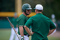 USF Bulls Joe Genord (20) talks with coach Greg Parris during a game against the Dartmouth Big Green on March 17, 2019 at USF Baseball Stadium in Tampa, Florida.  USF defeated Dartmouth 4-1.  (Mike Janes/Four Seam Images)
