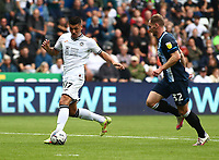 25th September 2021; Swansea.com Stadium, Swansea, Wales; EFL Championship football, Swansea versus Huddersfield; Joel Piroe of Swansea City gets through on goal and scores his sides first goal to make it 1-0 in the 18th minute