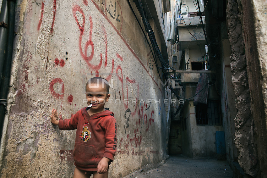 Kid palying alone in the streets of the Shatila camp. Beirut. Lebanon. August 2015