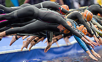 31 MAY 2014 - LONDON, GBR - Helen Jenkins (GBR) (WAL) (left) of Great Britain and Wales dives into the water at the start of the swim at the elite women's 2014 ITU World Triathlon Series round in Hyde Park, London, Great Britain (PHOTO COPYRIGHT © 2014 NIGEL FARROW, ALL RIGHTS RESERVED)