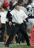 State College, PA - 09/15/2012:  Penn State head coach Bill O'Brien congratulates a member of his coaching staff after the fumble recovery for a touchdown.  Penn State defeated Navy by a score of 34-7 on Saturday, September 15, 2012, at Beaver Stadium.  The win was the first for new Penn State head coach Bill O'Brien...Photo:  Joe Rokita / JoeRokita.com..Photo ©2012 Joe Rokita Photography