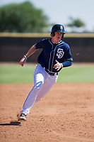 San Diego Padres designated hitter Blake Hunt (12) hustles towards third base during an Instructional League game against the Texas Rangers on September 20, 2017 at Peoria Sports Complex in Peoria, Arizona. (Zachary Lucy/Four Seam Images)