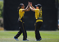 Wellington captain Leigh Kasperek congratulates Maneka Singh (left) on a wicket during the women's Hallyburton Johnstone Shield cricket match between the Wellington Blaze and Central Hinds at Karori Park in Wellington, New Zealand on Saturday, 30 November 2019. Photo: Dave Lintott / lintottphoto.co.nz