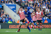 Pierre-Emile Hojbjerg of Southampton battles with Danny Drinkwater of Leicester City during the Premier League match between Leicester City and Southampton at the King Power Stadium, Leicester, England on 2 October 2016. Photo by Andy Rowland.