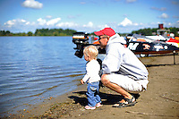 Ed Hearn and daughter check the water.