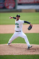 Clinton LumberKings relief pitcher Jeffeson Medina (31) delivers a pitch during a game against the Lansing Lugnuts on May 9, 2017 at Ashford University Field in Clinton, Iowa.  Lansing defeated Clinton 11-6.  (Mike Janes/Four Seam Images)
