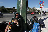 Pictured: A refugee mother and her child outside the Helliniko refugee camp Friday 26 February 2016<br />Re: Refugees have been turning up at the Helliniko refugee camp in the outskirts of Athens, Greece.