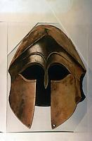 Greek Arms:  Corinthian Helmut.    ATLAS OF ANCIENT GREECE, p. 135.