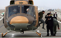 Iranian President Mahmoud Ahmadinejad jumps out of his helicopter during a provincial visit in Isfahan (Esfahan).
