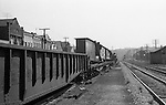 Oakmont PA:  View of an Ingalls Steel girder being transported by the Pennsylvania Railroad at the Oakmont Station. The structural beam was fabricated by Ingalls Iron Works for use in highway construction.
