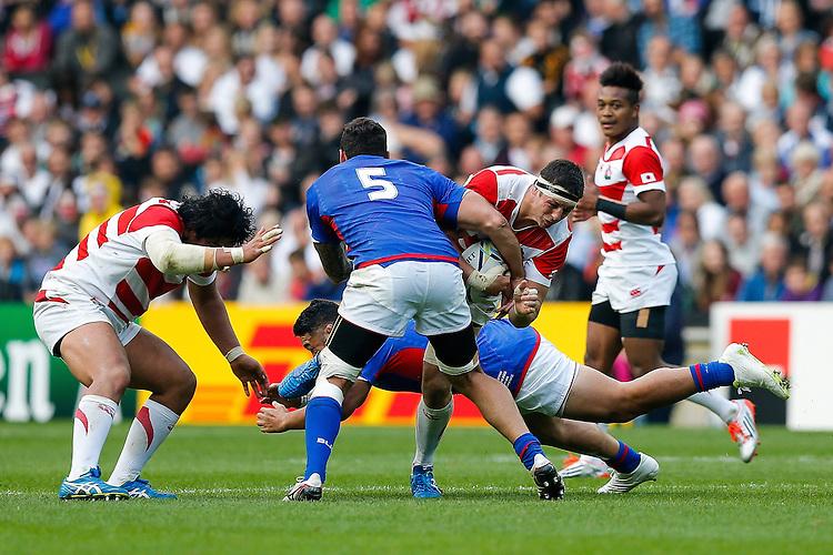 Japan Lock Luke Thompson is tackled by Samoa Lock Kane Thompson - Mandatory byline: Rogan Thomson - 03/10/2015 - RUGBY UNION - Stadium:mk - Milton Keynes, England - Samoa v Japan - Rugby World Cup 2015 Pool B.
