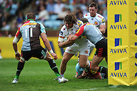 Alec Hepburn of Exeter Chiefs is stopped short of the line by Nick Evans of Harlequins during the Aviva Premiership match between Harlequins and Exeter Chiefs at The Twickenham Stoop on Saturday 7th May 2016 (Photo: Rob Munro/Stewart Communications)