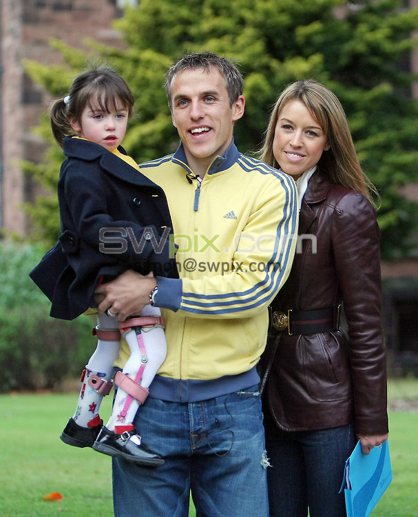 PICTURE BY VAUGHN RIDLEY/SWPIX.COM - Football Feature - Phil Neville - Bolton School, Bolton, England - 12/11/07...Copyright - Simon Wilkinson - 07811267706..Everton's Phil Neville, his wife Julie and daughter Isabella at Bolton School in Bolton where Isabella attends school.  The family were there today to promote and raise funds for the new Children's Hospital being built in Manchester.