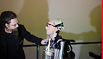 """World's first bionic man at Science museum today.5.2.13..Pic shows: the man who built the bionic man Rich Walker - CEO of Shadow Robots...Bertold Meyer - who has a bionic hand himself - with the robot """"Rex"""".as TV crews look on.Face of Rex was modelled on Bertold....Pic by Gavin Rodgers/Pixel 8000 Ltd"""