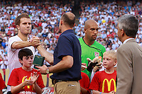USA goalkeeper Kasey Keller shakes hands with midfielder Michael Bradley (4) after being honored for his 100th appearance. The men's national teams of the United States and Argentina played to a 0-0 tie during an international friendly at Giants Stadium in East Rutherford, NJ, on June 8, 2008.