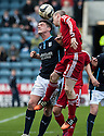Dundee's Stephen McGinn and Aberdeen's Willo Flood challenge for the ball.