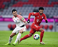 3rd January 2021, Allianz Arean, Munich Germany; Bundesliga Football, Bayern Munich versus FSV Mainz; Danny Latza (FSV Mainz 05) beaten by the turn from Serge Gnabry (Bayern Munich)