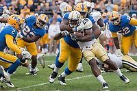 Pitt defensive lineman Tyrique Jarrett (6) makes a key tackle on Georgia Tech running back Dedrick Mills (26). The Pitt Panthers defeated the Georgia Tech Yellow Jackets 37-34 at Heinz Field in Pittsburgh, Pennsylvania on October 08, 2016.
