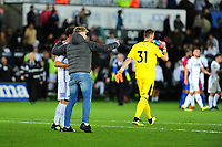 a fan runs onto the pitch to take a selfie with Liam Cullen of Swansea City during the Carabao Cup Second Round match between Swansea City and Crystal Palace at Liberty Stadium, in Swansea, Wales. August 28, 2018