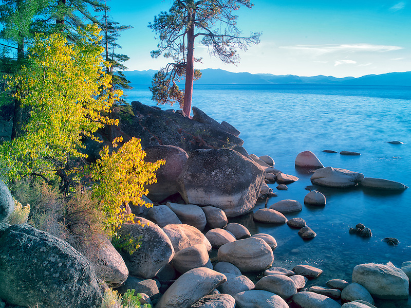 Boulder rocks and fall color on shoreline of Lake Tahoe, Nevada