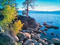 Boulder rocks and fall color on shoreline of Lake Tahoe, Nevada