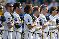 Michigan Wolverines lineup for the National Anthem before Game 2 of the NCAA College World Series Finals on June 25, 2019 at TD Ameritrade Park in Omaha, Nebraska. Vanderbilt defeated Michigan 4-1. (Andrew Woolley/Four Seam Images)