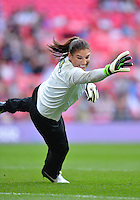 August 09, 2012: United States goalkeeper Hope Solo warms up before Football Final match at the Wembley Stadium on day thirteen in Wembley, England. USA defeat Japan 2-1 to win it's third consecutive Olympic gold medal in women's soccer. ..