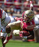 Florida State running back Cam Akers gets upended by Northern Illinois University on September 22, 2018 in Tallahassee, Florida.  The Seminoles defeated the Huskies 37-19.