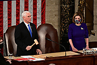 Speaker of the United States House of Representatives Nancy Pelosi (Democrat of California), right, listens as U.S. Vice President Mike Pence speaks during a joint session of Congress to count the Electoral College votes of the 2020 presidential election in the House Chamber in Washington, D.C., U.S., on Wednesday, Jan. 6, 2021. Congress is meeting to certify Joe Biden as the winner of the 2020 presidential election, with scores of Republican lawmakers preparing to challenge the tally in a number of states during what is normally a largely ceremonial event. <br /> Credit: Erin Scott / Pool via CNP/AdMedia