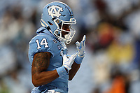 CHAPEL HILL, NC - NOVEMBER 23: Emery Simmons #14 of the University of North Carolina celebrates a touchdown during a game between Mercer University and University of North Carolina at Kenan Memorial Stadium on November 23, 2019 in Chapel Hill, North Carolina.