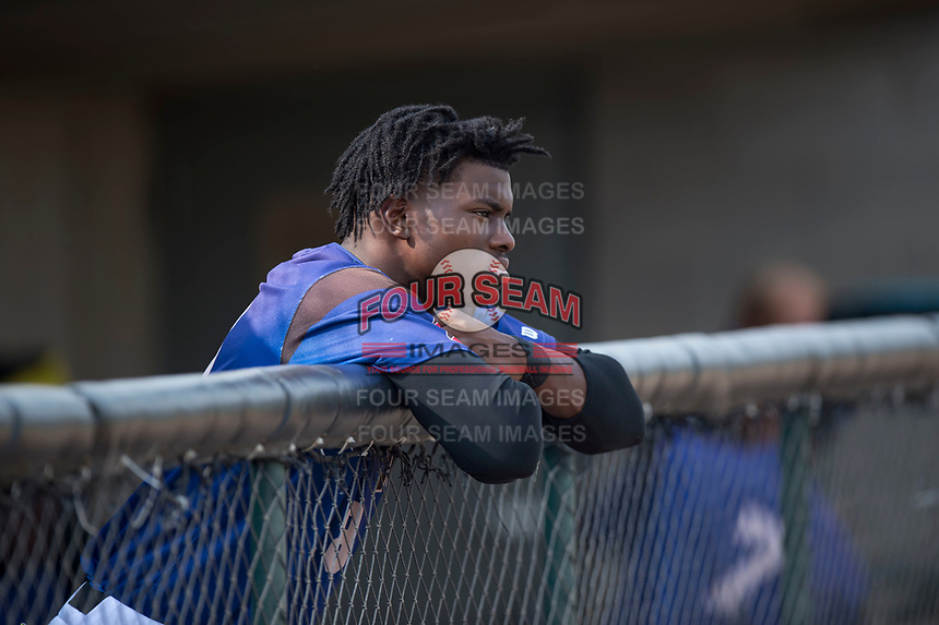 Missoula Osprey outfielder Kristian Robinson (18) in the dugout before a Pioneer League game against the Orem Owlz at Ogren Park Allegiance Field on August 19, 2018 in Missoula, Montana. The Missoula Osprey defeated the Orem Owlz by a score of 8-0. (Zachary Lucy/Four Seam Images)