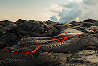 Active lava surface flow a few hundred yards from a lava tube entering the ocean at Hawai'i Volcanoes National Park, Kalapana, Big Island.
