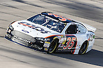 Sprint Cup Series driver David Reutimann (35) in action during the Nascar Sprint Cup Series Duck Commander 500 practice at Texas Motor Speedway in Fort Worth,Texas.