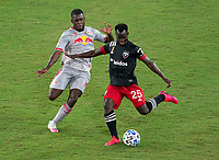 WASHINGTON, DC - SEPTEMBER 12: Dru Yearwood #16 of the New York Red Bulls defends Mohammed Abu #25 of D.C. United during a game between New York Red Bulls and D.C. United at Audi Field on September 12, 2020 in Washington, DC.