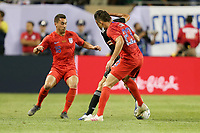 CHICAGO, ILLINOIS - JULY 07: Daniel Lovitz #16, Aaron Long #23 during the 2019 CONCACAF Gold Cup Final match between the United States and Mexico at Soldier Field on July 07, 2019 in Chicago, Illinois.