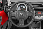 Steering wheel view of a 2009 - 2012 Citroen C1 Airplay 5-Door Micro Car Hatchback