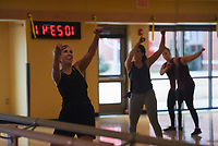 Instructor Nicole Frodelly (left) leads a dance class, Monday, January 11, 2021 at the Bentonville Community Center in Bentonville. Attendees participated in the twice-weekly, high-energy Dance Fit class. Check out nwaonline.com/210112Daily/ for today's photo gallery. <br /> (NWA Democrat-Gazette/Charlie Kaijo)