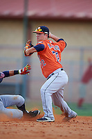 Houston Astros Brooks Marlow (72) throws to first as Alejandro Salazar (34) slides in during an instructional league game against the Atlanta Braves on October 1, 2015 at the Osceola County Complex in Kissimmee, Florida.  (Mike Janes/Four Seam Images)
