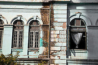 Myanmar, Burma, Yangon.  Deteriorating Buildings, Plaster Falling off Brick Buildings Built in Colonial Era.