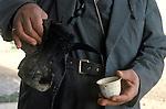 Marsh Arabs. Southern Iraq.  Marsh Arab man pouring coffee. 1984