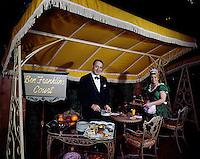 Cheerful waiter and waitress in restaurant