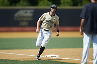 Jake Mueller (6) of the Wake Forest Demon Deacons rounds third base following the home run by Bobby Seymour (not pictured) against the Virginia Cavaliers at David F. Couch Ballpark on May 19, 2018 in  Winston-Salem, North Carolina. The Demon Deacons defeated the Cavaliers 18-12. (Brian Westerholt/Four Seam Images)