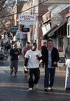 Interracial couple walking on corner