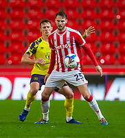 21st November 2020; Bet365 Stadium, Stoke, Staffordshire, England; English Football League Championship Football, Stoke City versus Huddersfield Town; Nick Powell of Stoke City shields with his eye on the ball